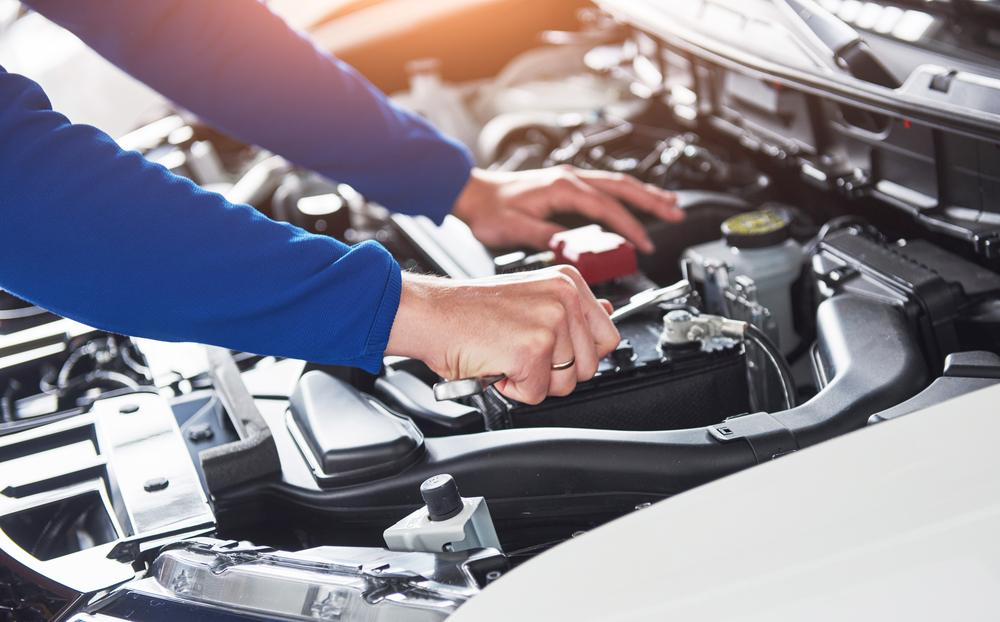 mechanic hands fixing car in texas