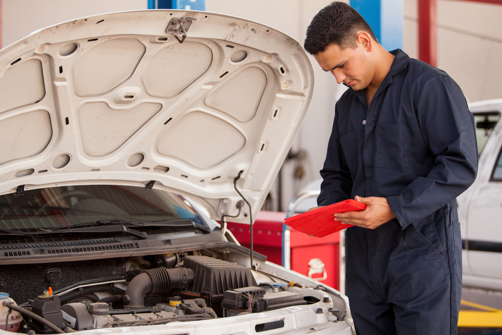 mechanic giving maintenance to a car in texas