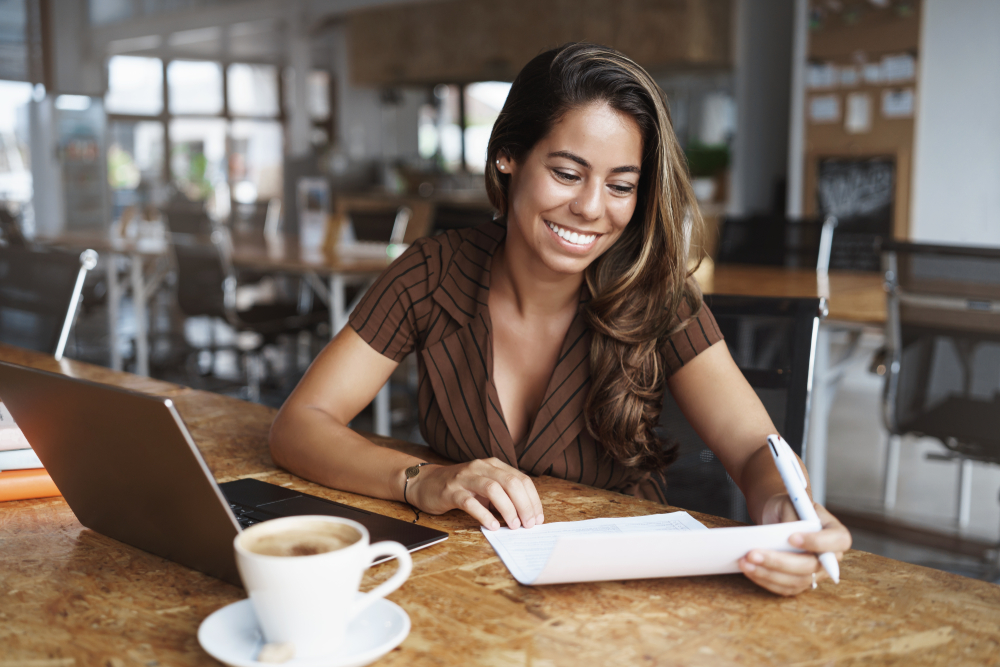 happy young woman looking at auto insurance policy