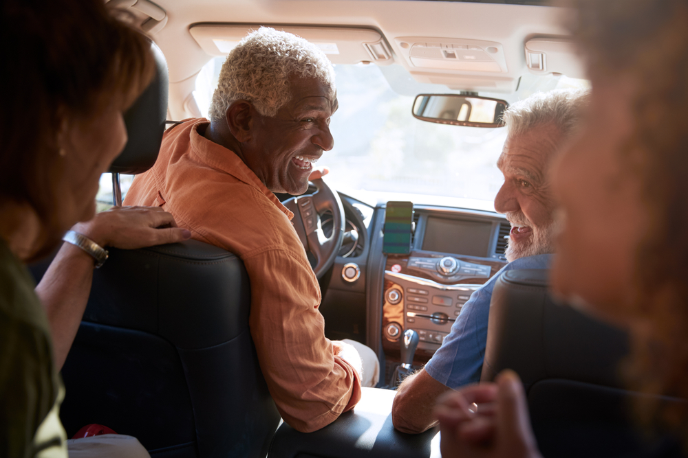 Group Of Senior Friends Enjoying Road Trip In Car Together